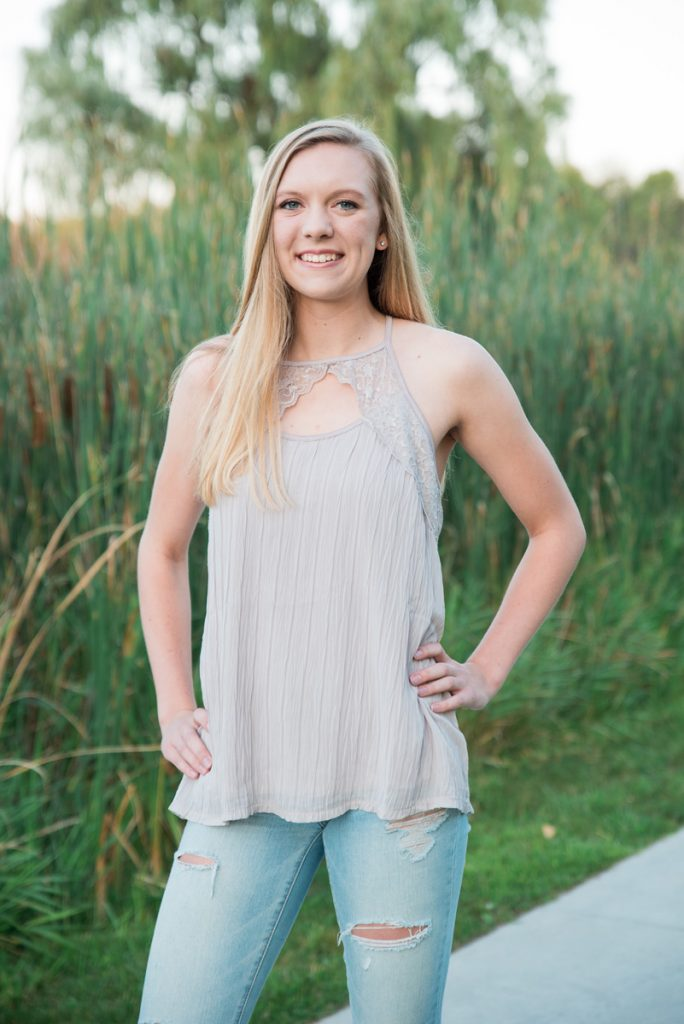 high school senior girl portraits in front of cattails