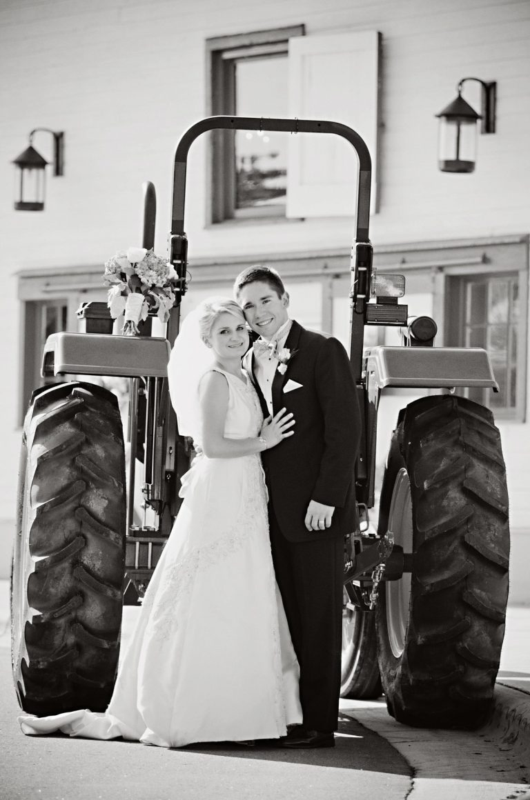 Meghan-and-Joe-Goering-at-Wedding-Reception-with-John-Deere-Tractor