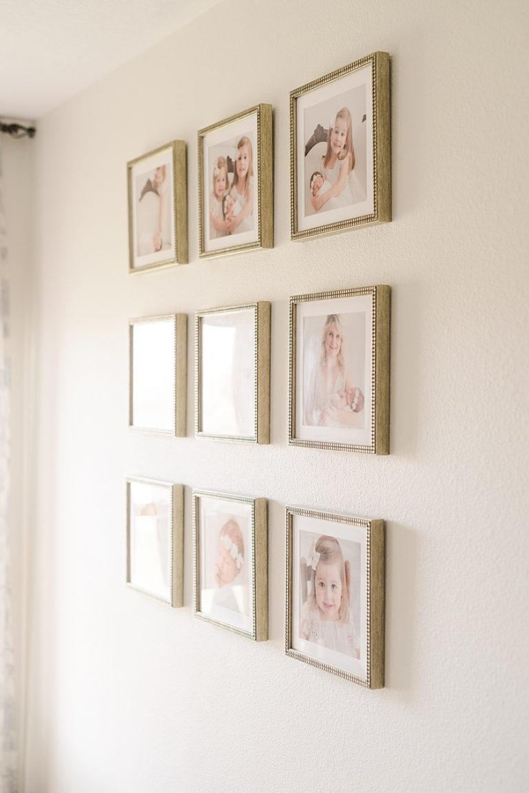 Three by Three Wall Gallery of 10 in by 10 inch square gold picture frames with white matting