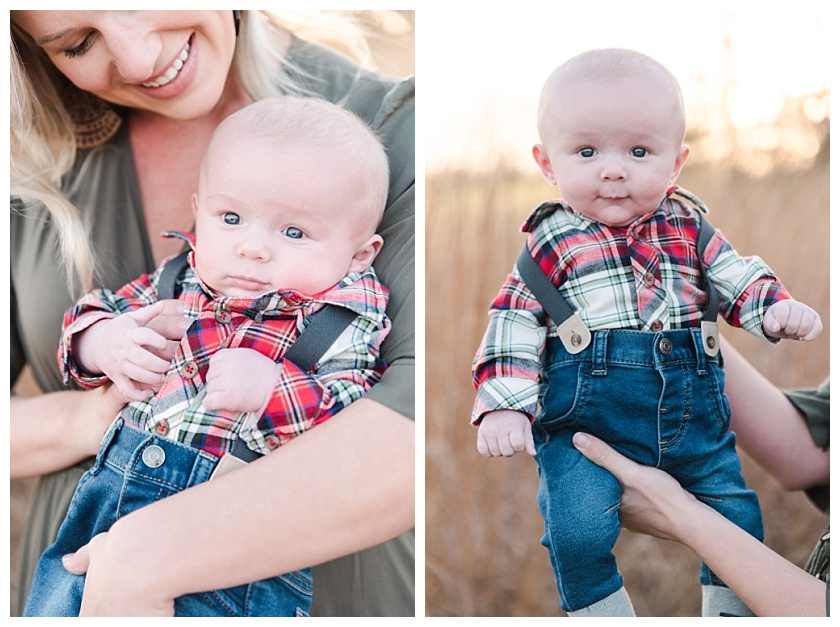 Mom holding 3 month old boy up in front of Cedar Falls Iowa prairie field