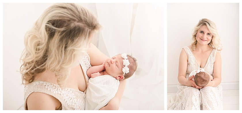 Mother sitting on the floor holding newborn baby girl and wearing beautiful lulu's dress