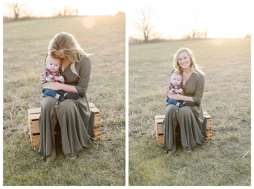 mom snuggling baby boy while sitting on an old milk crate with Cedar Falls Field in the background