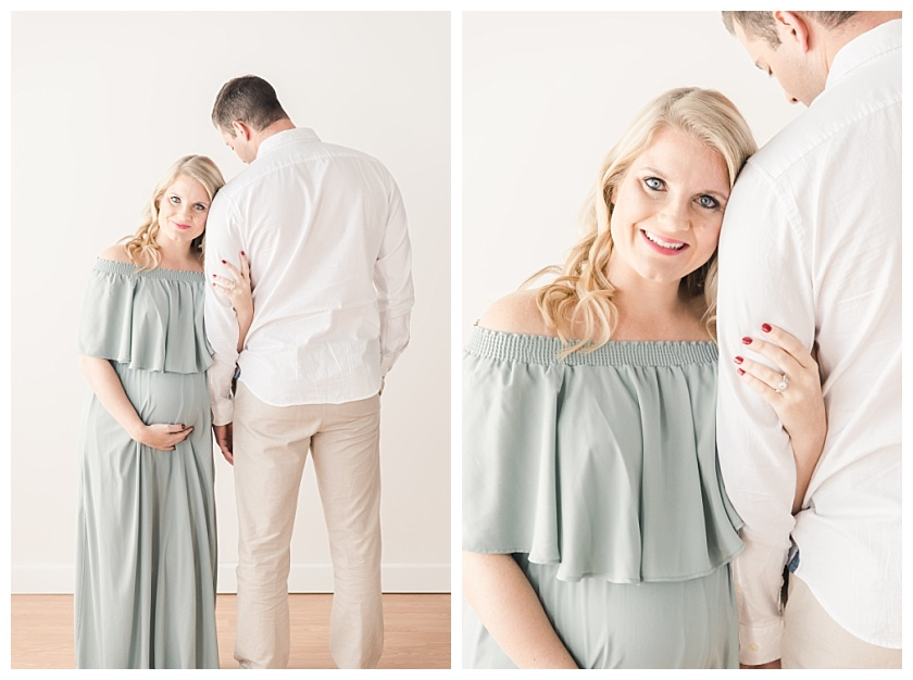 Maternity Photos with mom resting her head on husband's shoulder and smiling by meghan goering photography