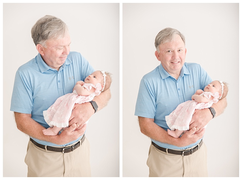 grandpa holding newborn granddaugther and smiling by meghan goering photography