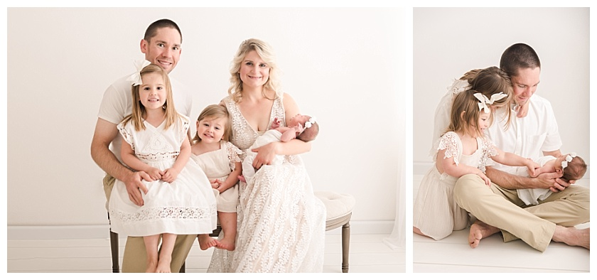 Family of 5 in Cedar Falls Photography Studio on semi circle bench dressed in white with newborn