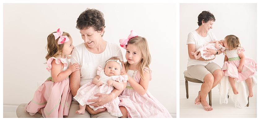grandmother smiling down at her granddaughters in the studio
