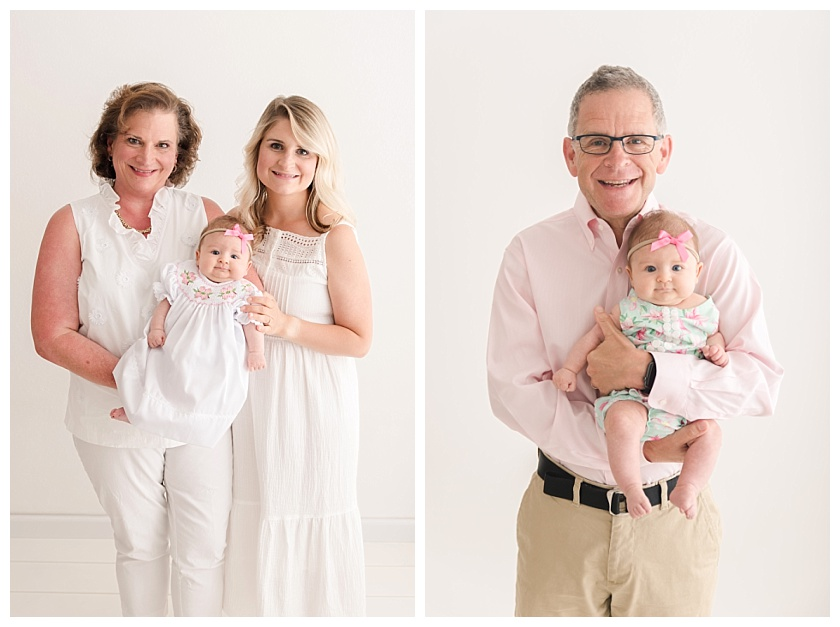 grandpa with glasses holding cute granddaughter with chubby cheeks by meghan goering photography