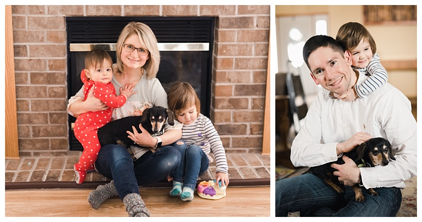 mom and daughters with black and brown miniature dachshund in front of fire place