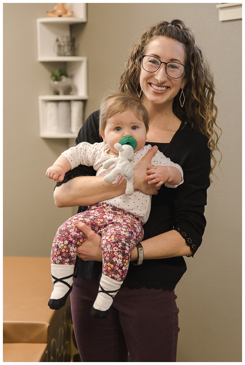 cedar falls chiropractor dr sara cahill with baby girl