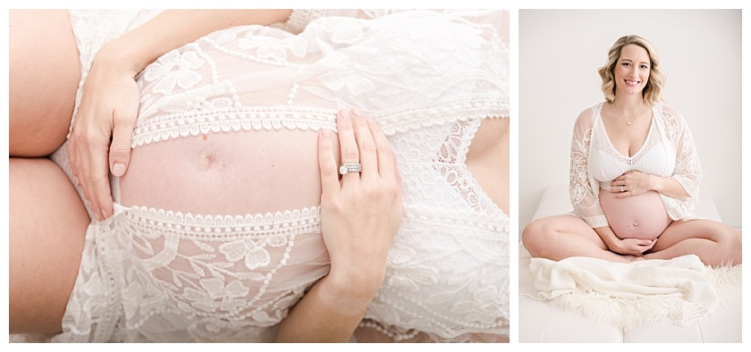 boudoir photo of maternity client holding her belly and sitting on a white futon