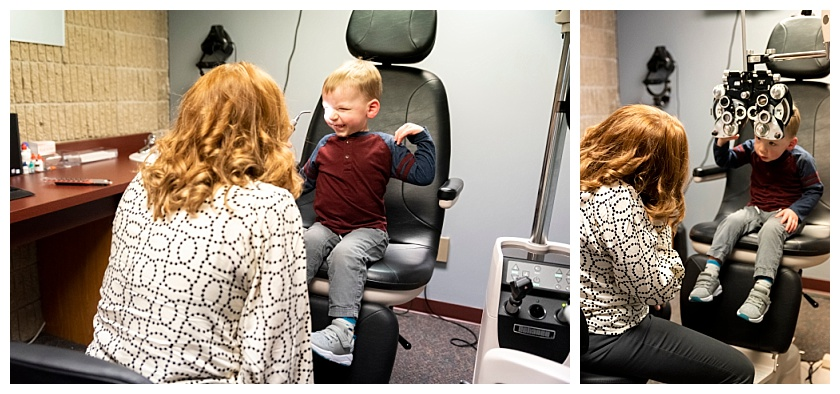 little boy laughs and enjoys eye exam with eye doctor