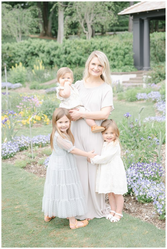 Mother with three little girls at Reynolda Gardens in Winston Salem, NC by Meghan Goering Photography